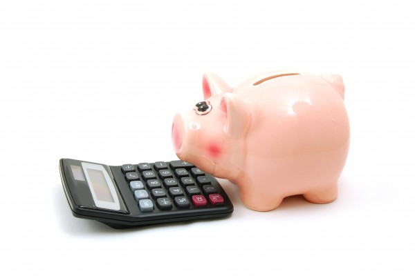 piggy bank and calculator showing saving concept
